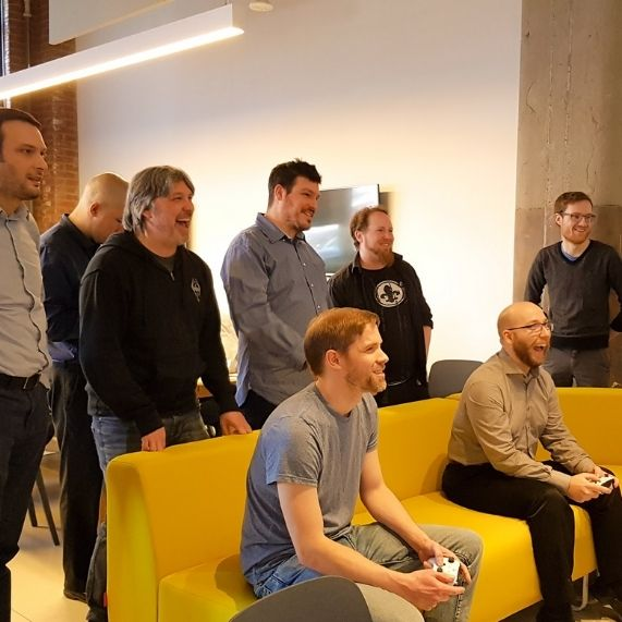 Logibec-join-our-team-group-of-employees-playing-video-games